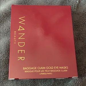 Baggage claim gold eye masks